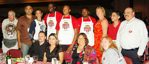 49ers Players Give Up Playbooks and Gridiron Gear for Aprons and Fun Times