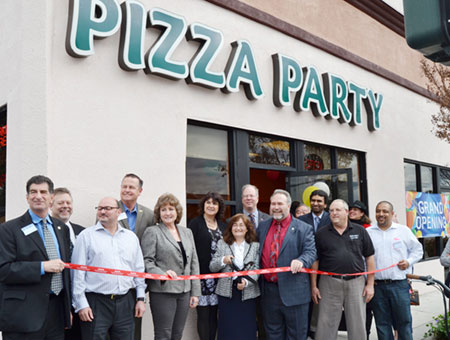 Pizza Party Celebrates With Ribbon Cutting at New Location