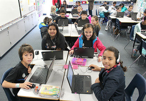 Fifth Graders at Laurelwood School Practice Computer Programming During the Hour of Code