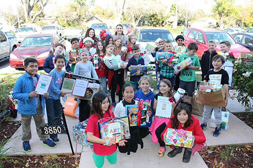 Sutter School Students Bring Holiday Donations to the JW House