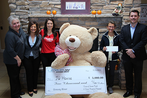 Giant Teddy Bear Delivers $5,000 Check to JW House in a Silver Lexus Convertible