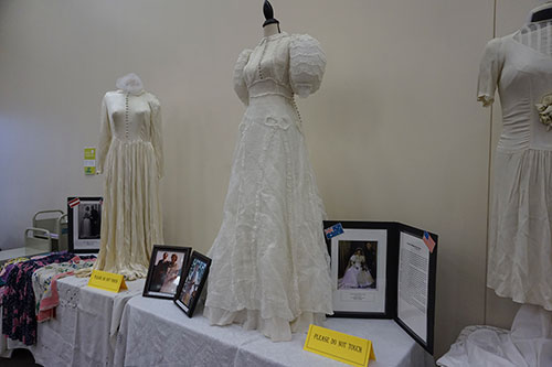 Headline: WWII wedding dresses displayed at library