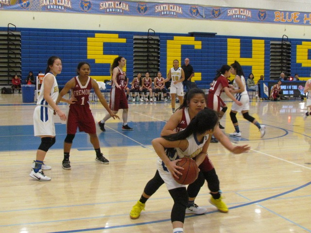 The Santa Clara Bruins and Fremont Firebirds basketball squads battled it out during the first half of their Tuesday game. The Bruins won.