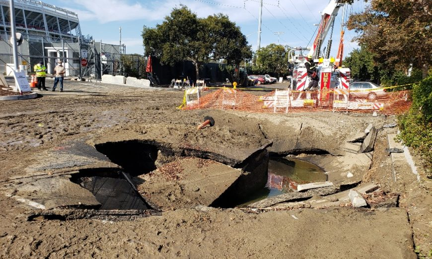 A sinkhole developed and ate two cars at the VTA parking lot near Santa Clara's Levi's Stadium. The City says a water pipe leak occured.